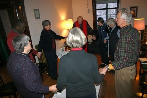 "Mass in the Living Room of the Monastery: Congregants pray ""Our Father"""