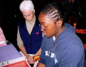 Sr. Katherine and a young woman in prayer