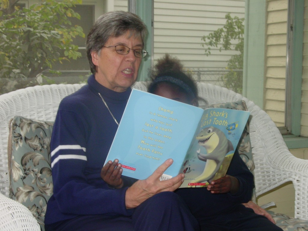 Care to title this image of Sr. Mary Frances and a child from the neighborhood?