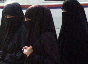 """Wearing the niqab. (From """"Faith of Muslims"""" )"""