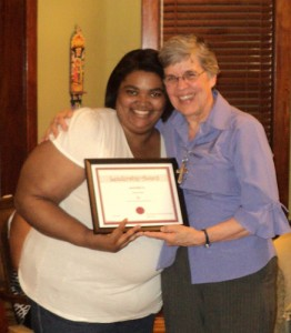 Bianca Franks embraced by Sr. Mary Frances Reis, VHM