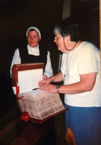 S. Suzanne signing the Vow Book of the Monastery of Annecy, France in June, 2009 during the 400th Anniversary Pilgrimage.