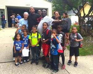 Eddie Brown with S. Katherine and neighborhood children at the back to school party.